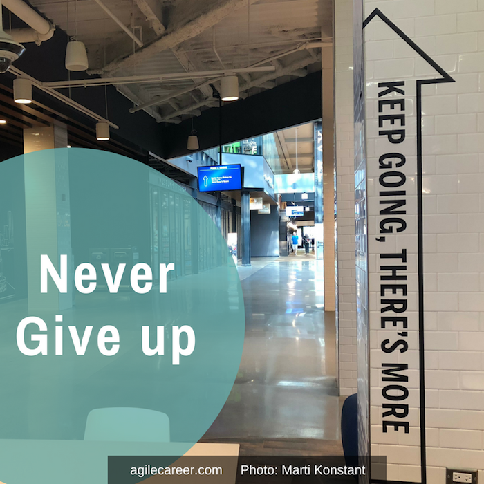 Neve-give-up-graphic-with-keep-going-sign