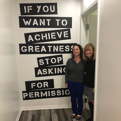 Two-women-standing-next-to-wall-quote-about-permission